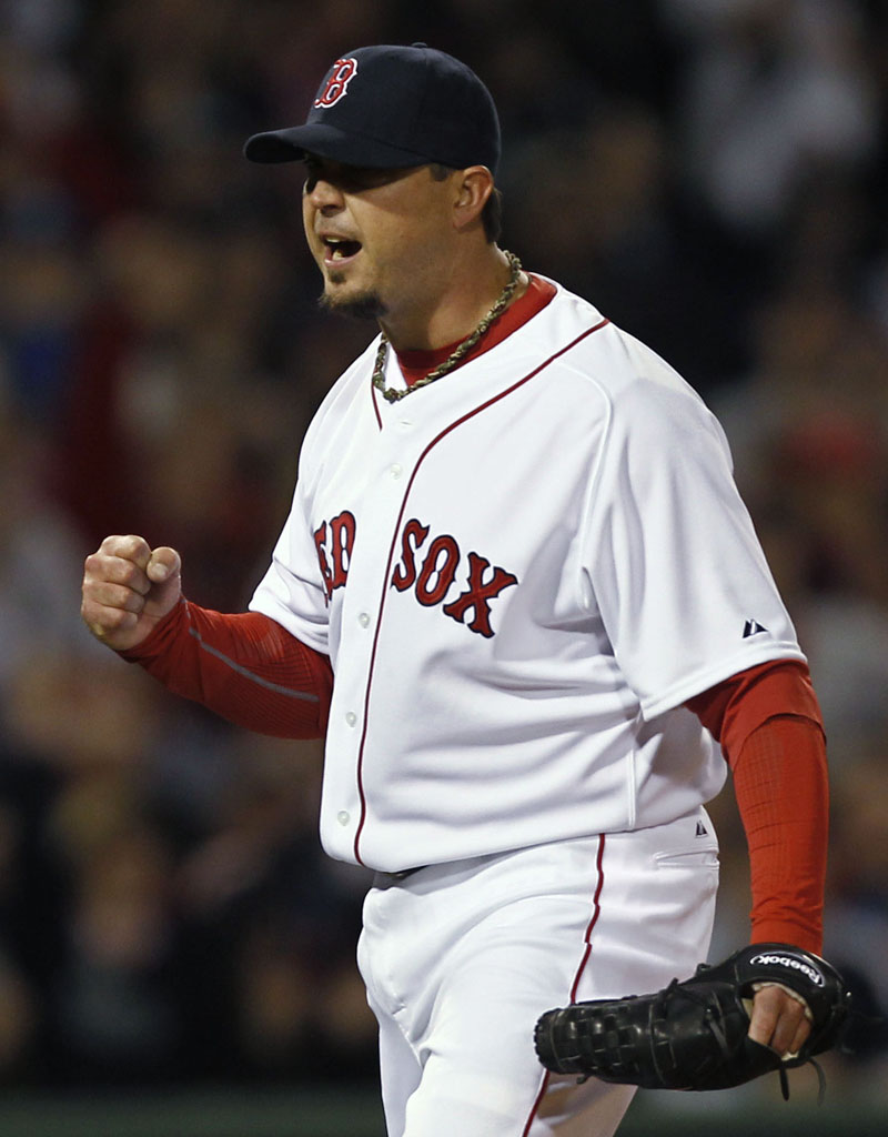 Boston pitcher Josh Beckett pumps his fist after the Red Sox turned a double play against the New York Yankees during the third inning Sunday night at Fenway Park in Boston.