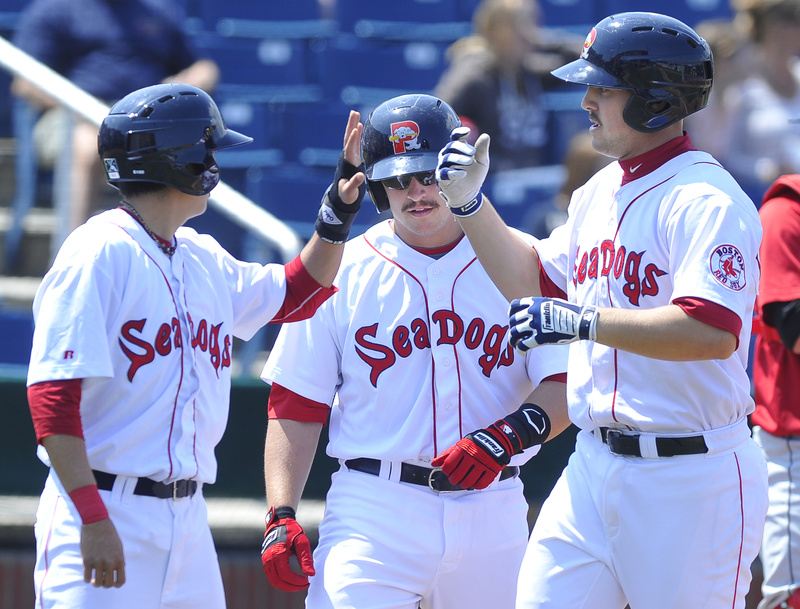 Ryan Lavarnway, right, gets congrats from teammates after his homer in Saturday's 15-7 win over the New Britain Rock Cats at Hadlock Field.