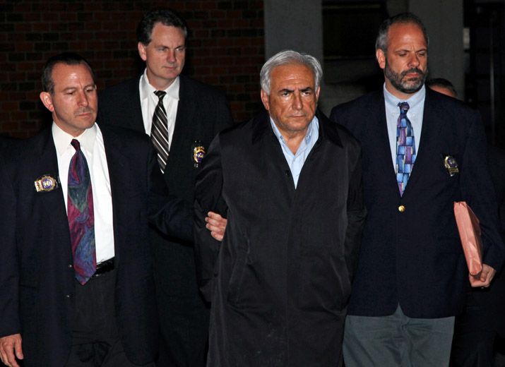 Dominique Strauss-Kahn, head of the International Monetary Fund, is led from a police station in New York where he was being held.