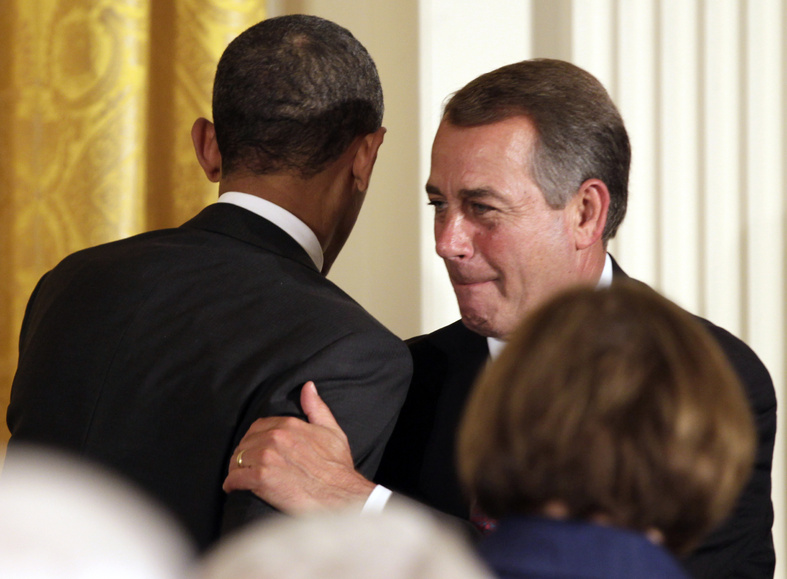 """President Obama, right, is greeted by House Speaker John Boehner, R-Ohio, as he arrives to speak during a dinner for a bipartisan group of congressional leaders and ranking members and their spouses at the White House on Monday. """"Last night's news unified our country"""" much as the terrorist attacks of 2001 did, Boehner said earlier in the day."""