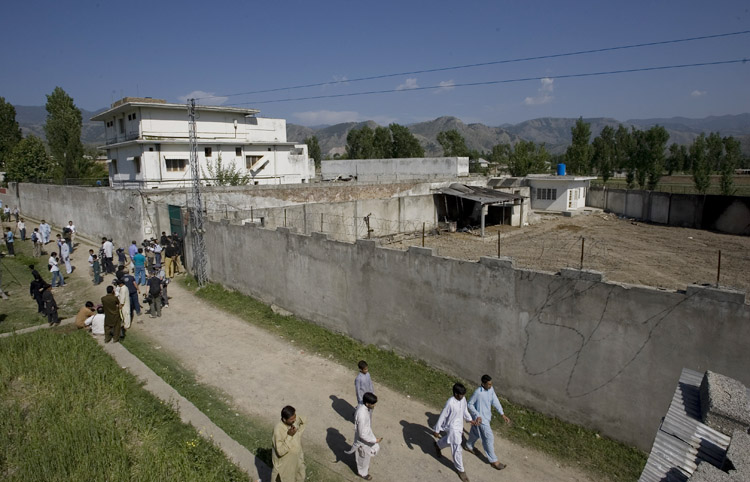Media and local residents gather today outside the house in Abbottabad, Pakistan, where al-Qaida leader Osama bin Laden was killed.