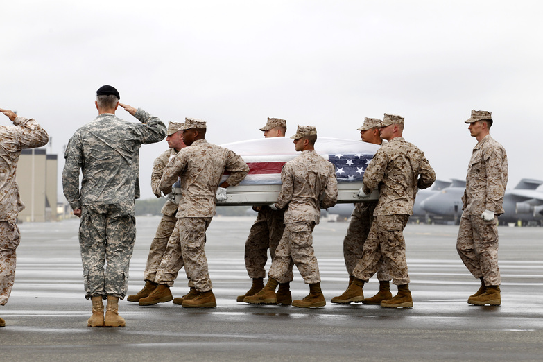 A Marine team carries the remains of Marine Sgt. Kevin B. Balduf of Nashville, Tenn., upon arrival at Dover Air Force Base, Del., on Saturday. Balduf was married to a woman from Richmond, Maine.
