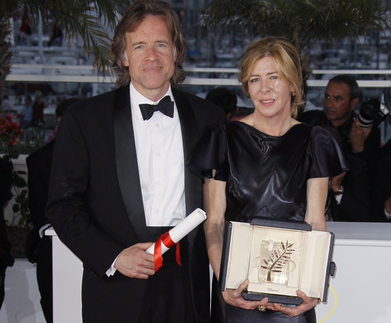 Producers Bill Pohlad, left, and Dede Gardner hold the Palme d'Or for the film