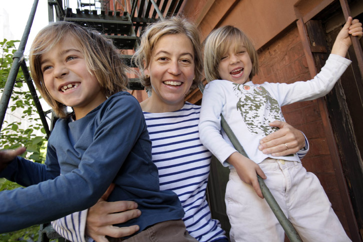 Amy Richards with her sons Webber Sloan, 7, left, and Beckett Sloan, 5, on a fire escape at their apartment in New York. Richards is a feminist activist and author of