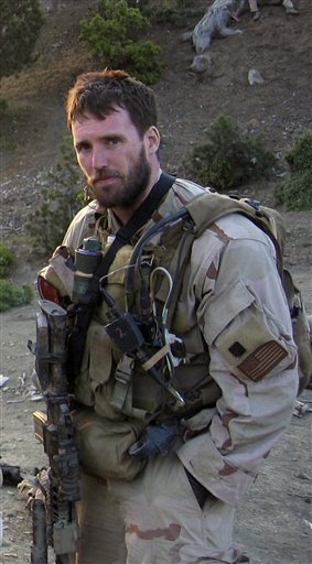 This undated file photo released by the U.S. Navy shows Navy Seal Lt. Michael P. Murphy, from Patchogue, N.Y. Murphy who was killed while leading a reconnaissance mission deep behind enemy lines in Afghanistan received the nation's highest military award for valor _ the Medal of Honor, A warship bearing the name of the Medal of Honor winner will be christened on what would have been his 35th birthday Saturday, May 7, 2011 at Bath Iron Works, where the 9,500-ton destroyer is being built. (AP Photo/U.S. Navy, File) BUDS LT Lieuenant kia medal of honor MOH