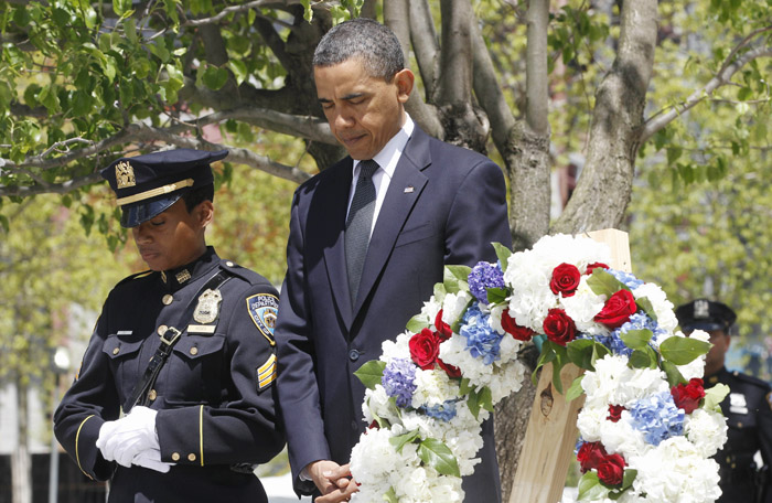 President Barack Obama pauses after laying a wreath at the National Sept. 11 Memorial at Ground Zero in New York today.