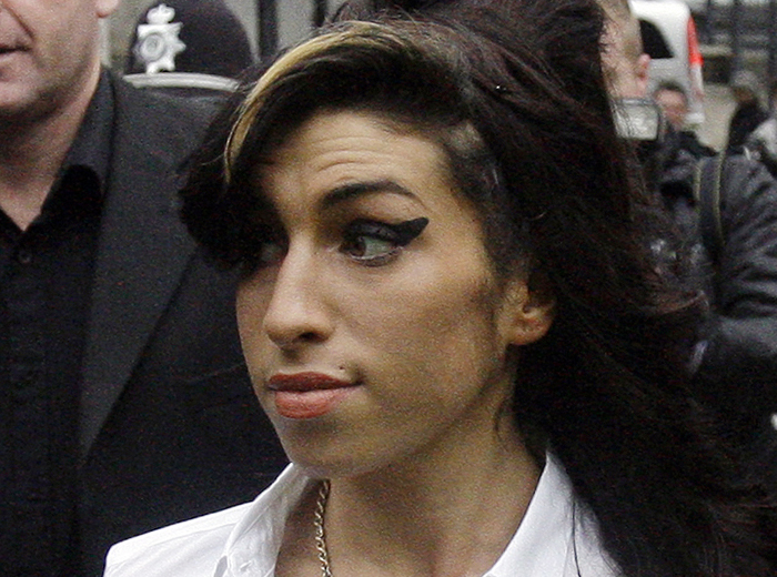 In this 2010 photo, British singer Amy Winehouse arrives at Magistrates Court in Milton Keynes, England.