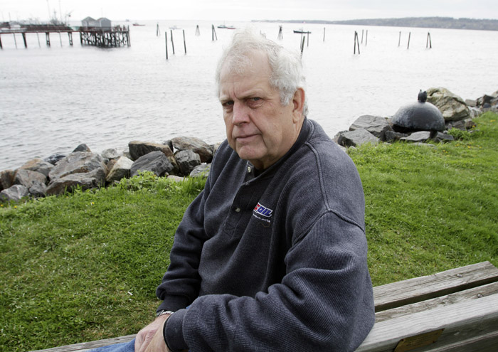 Author and former Navy underwater photographer Steve Waterman sits on the waterfront in Rockland, Maine, recently. Waterman says it's easy to ferret out the real Navy SEALs from the phonies. Dead giveaways are loose tongues and bravado.