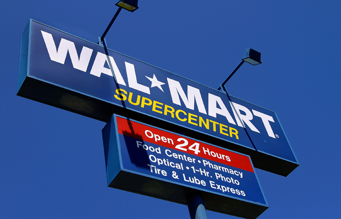 Walmart says its low-income customers are having a harder time stretching their dollars to the next payday than last year.