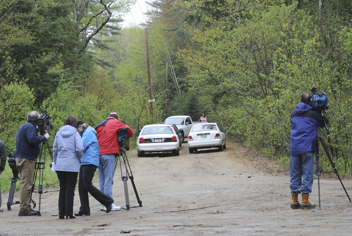 News media gather at the site where the body of a young boy was found off this dirt road, at 100 Dennett Road in South Berwick on Saturday.