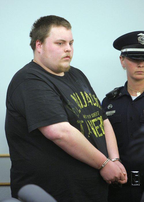 Gregory Rec/Staff Photographer: Trevor Ferguson, 23, is led in to Ossipee District Court in Ossipee, New Hampshire on Wednesday, May 11, 2011. Ferguson was arrested and arraigned in connection with the death of Krista Dittmeyer.