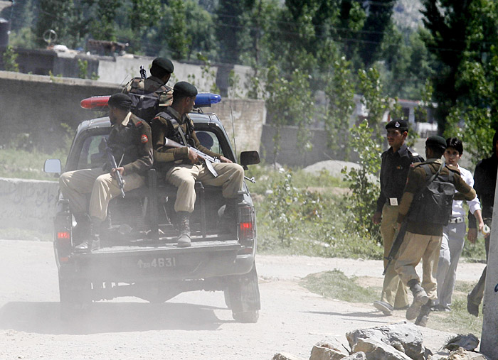 Pakistani soldiers patrol in the vicinity of a compound where it is believed al-Qaida leader Osama bin Laden lived in Abbottabad, Pakistan today.