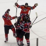 Tim Conboy is mobbed by teammates after scoring what turned out to be the winning goal for the Pirates.