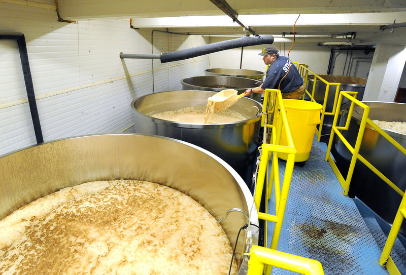 Brewer Erick Christensen strips yeast from a fermenter at Shipyard Brewing in Portland. The company is looking to expand its Florida market to keep production stable year-round.