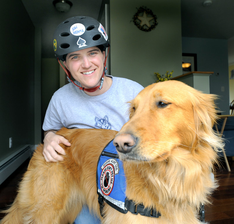 """Christy Gardner with her service dog """"Moxie"""" at her home in Lewiston. Moxie is on duty 24 hours a day, seven days a week, watching out for Gardner's safety."""