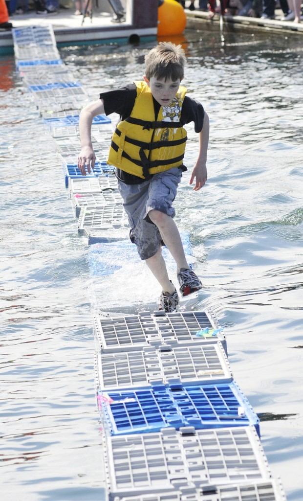 Three-time winner Brian Mcnamara shows his championship form in the lobster crate race.
