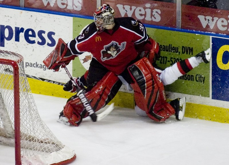 After sitting out the Pirates' loss in Game 2 against Binghamton, David Leggio returned to the lineup Saturday and made 32 saves in a 3-2 win. He kept Binghamton's Ryan Potulny away from the action on this play.
