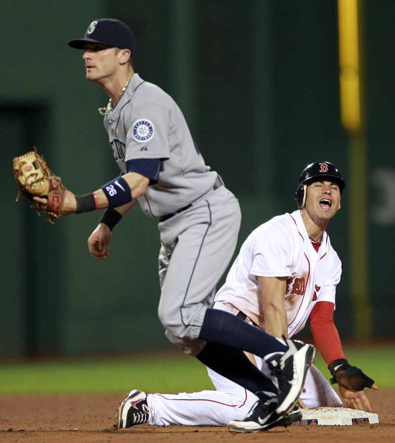 Seattle's Jack Wilson, left, forces out Jacoby Ellsbury at second base after a line drive by Boston's Adrian Gonzalez in the fifth inning Saturday night at Fenway Park. Seattle won 2-0, handing Boston its fourth loss in five games.