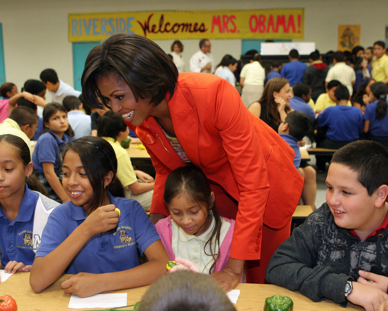 "Michelle Obama talks to fifth-graders at Riverside Elementary in Miami in 2010 about the start of ""Let's Move Salad Bars to Schools."" The public health initiative was launched in support of ""Let's Move,"" whose goal is to eliminate childhood obesity within a generation."