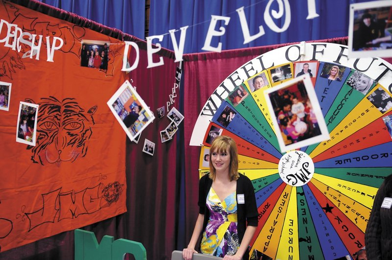 Holly Allen staffs Gardiner Area High School's booth at the Jobs for Maine's Graduates career development conference in Augusta. Several graduating seniors at last week's event say the program aided their resume-writing and interview skills.