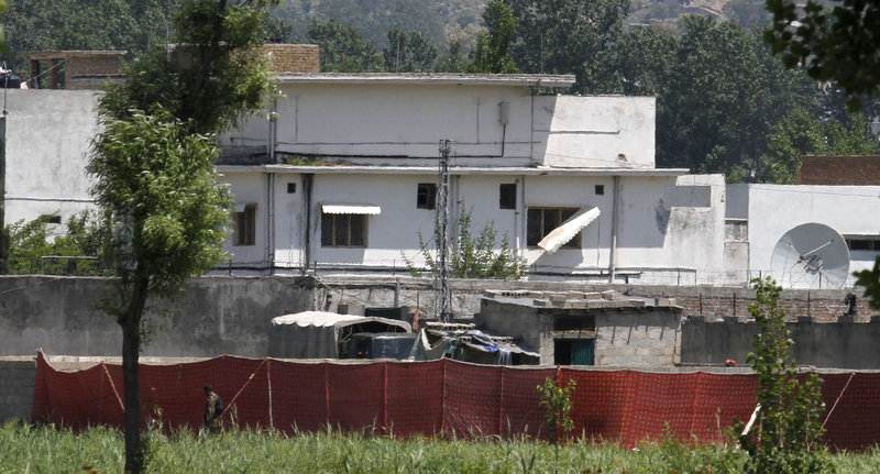 A Pakistani soldier stands near a compound where it is believed al-Qaida leader Osama bin Laden lived in Abbottabad, Pakistan, on Monday.