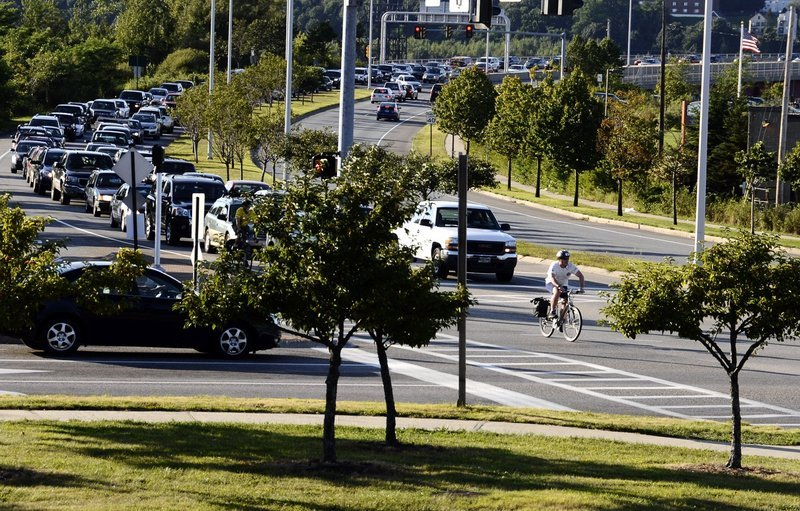 A bicyclist leads cars on a South Portland street, a reflection of road-use history, a reader says.