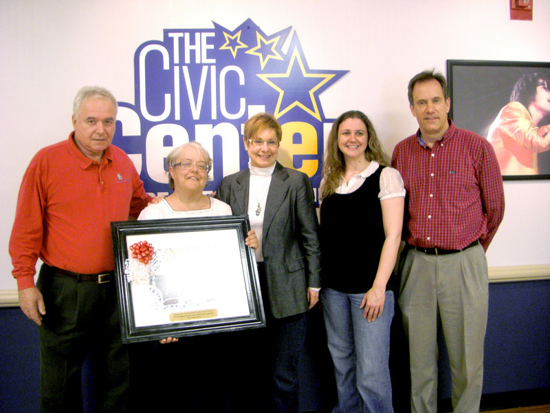 """Brenda S., second from left, an artist and consumer at Port Resources, presented her painting, """"the bridge,"""" to officials at the Cumberland County Civic Center for its support in providing consumers with tickets to events at the civic center. From left, Steve Crane, general manager of the civic center, Brenda S., Roberta Wright, event services director at the civic center, and Kimberly Hubbard and Eric Knutsen of Port Resources"""