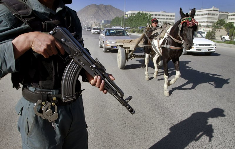 """An Afghan police officer stands guard at a check point in Kabul Tuesday. The killing of Osama bin Laden is seen as creating an """"opportunity for reconciliation that didn't exist before,"""" one official says, meaning a more palatable outcome for Americans and insulating Obama from criticism his administration would negotiate with terrorists."""