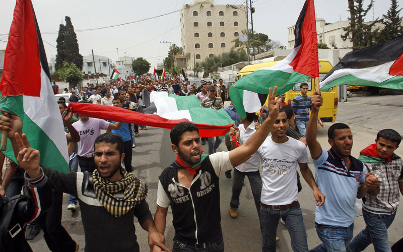 Palestinians celebrate a reconciliation agreement between Fatah and Hamas in Gaza City Wednesday. The accord would end a four-year rift between the bitter rivals and pave the way for a joint caretaker government.