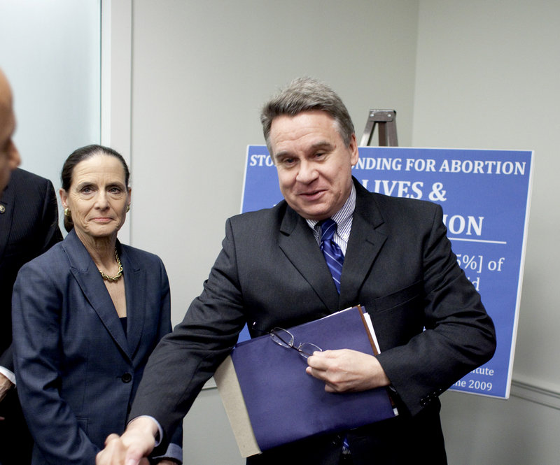 Rep. Jean Schmidt, R-Ohio, left, and Rep. Christopher Smith, R-N.J., arrive for a news conference on Capitol Hill in Washington Wednesday to discuss the No Taxpayer Funding for Abortion Act.