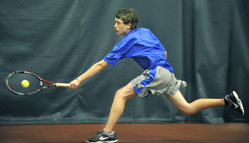 Brendan McCarthy of Falmouth stretches for a backhand return Wednesday against Ross Sherman of Cape Elizabeth. Falmouth swept the Capers, but every match between the top Western Class B teams was competitive.