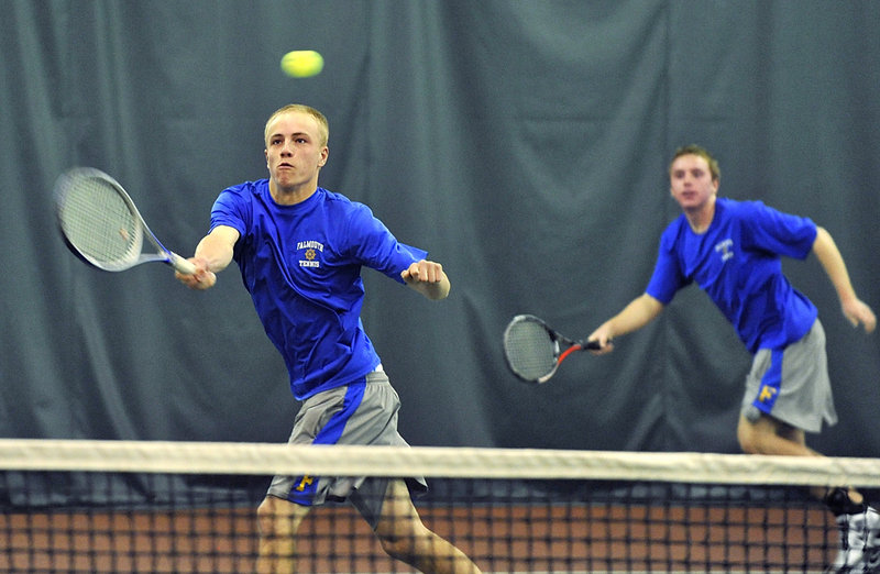 Connor Burfeind of Falmouth returns a shot as his doubles partner, Tom Wilberg, backs him up during a three-set victory.