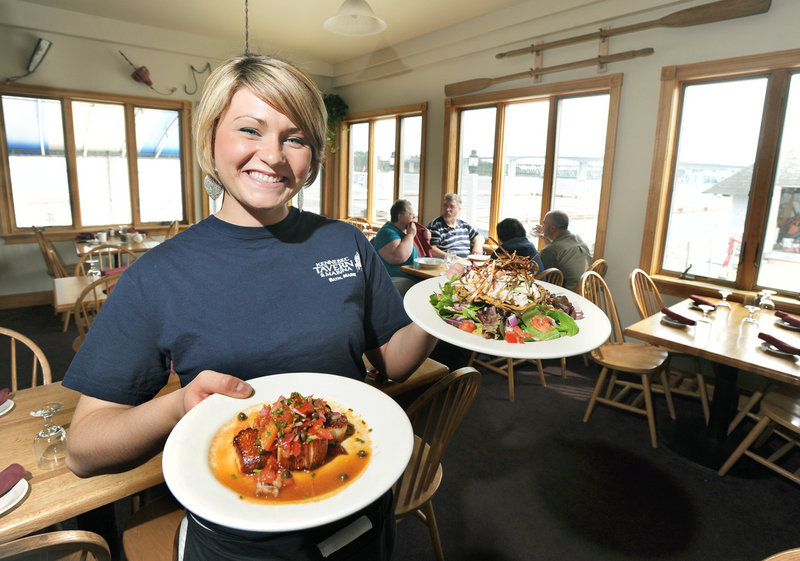 Samantha Hayslip serves a scallop appetizer and a lobster and fried mushroom salad at the Kennebec Tavern, on the river in Bath.