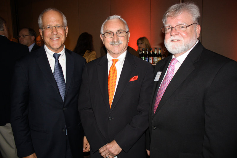 Recipients of this year's JoAnn Pike Humanitarian Award Andy Barowsky, president and CEO of Lepage Bakeries, with Albert Lepage, chairman, and Rick Small, who is president and CEO of Good Shepherd Food Bank.
