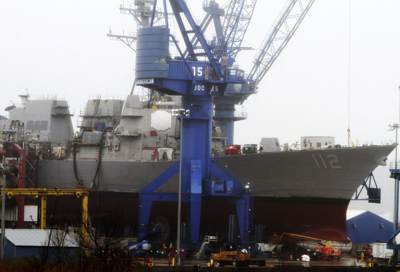 Work continues on the Navy warship Murphy at Bath Iron Works on Wednesday. The destroyer bearing the name of Medal of Honor recipient Lt. Michael Murphy will be christened Saturday on what would have been Murphy's 35th birthday.