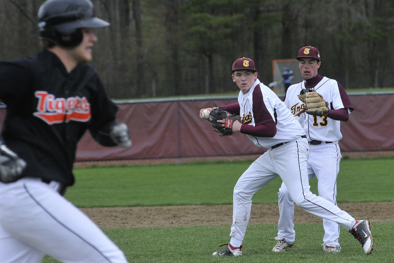 Jeff Gelinas of Thornton Academy sets to throw to first in an attempt to retire Nick Gagne of Biddeford, who reached on an infield single during their Telegram League game Thursday. Biddeford won 7-6 in nine innings. Sam Canales backs up.