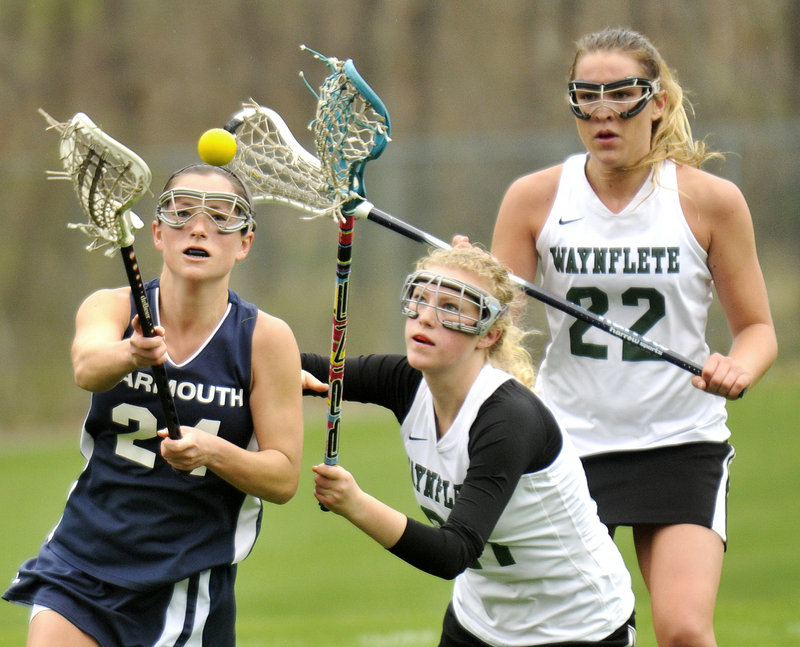 Danielle Torres of Yarmouth, left, and Lucy Crane of Waynflete compete for a loose ball Thursday during Waynflete's 11-10 victory at home. Moving in for the Flyers is Scout Haffenreffer. Waynflete improved to 3-1. Yarmouth is 3-1.