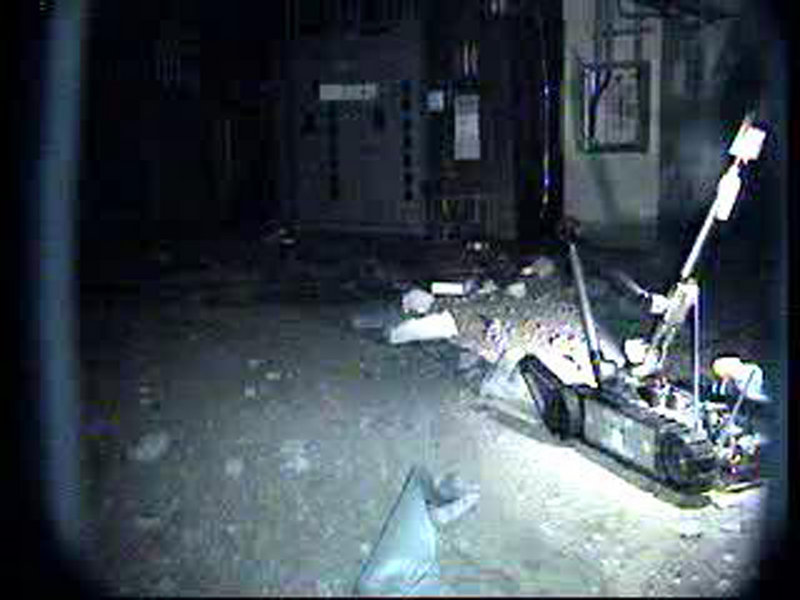 Tokyo Electric Power Co. released this file photo of a radio-controlled robot as it advances inside the reactor building of Unit 1 at the Fukushima Dai-ichi Nuclear Power Plant in Okuma. Japan's nuclear safety agency said workers entered the reactor building of Unit 1 Thursday for the first time since the March 11 earthquake.