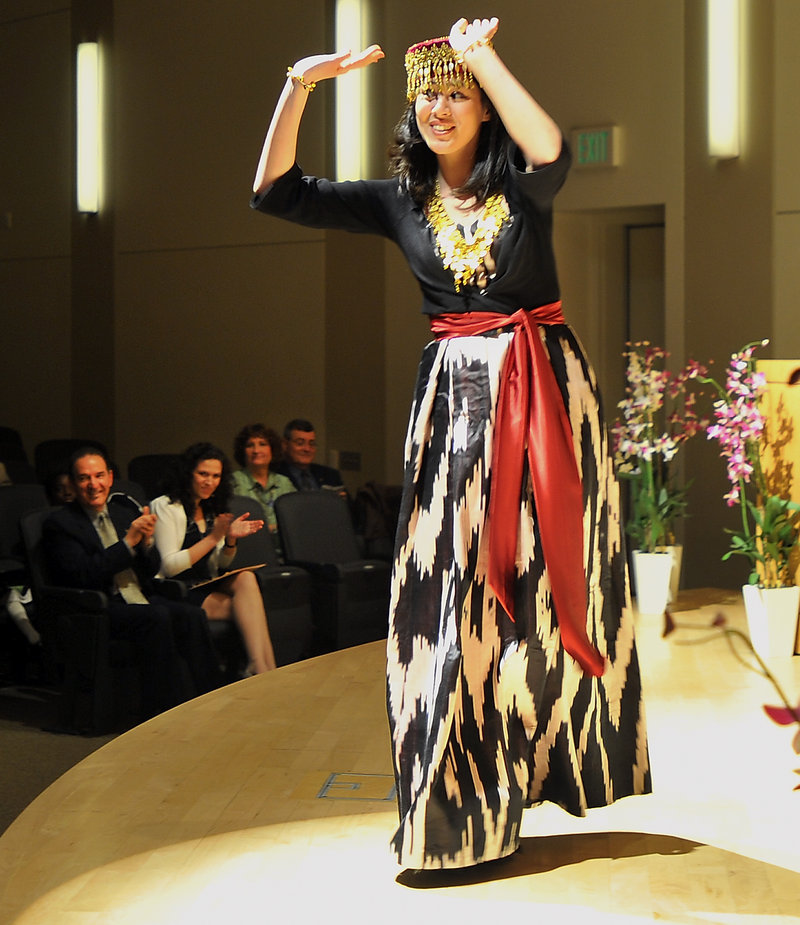 Malika Umarova, a student in the University of Southern Maine's Muskie School of Public Service, performs a traditional Khorezm dance from Uzbekistan during the annual multicultural and international student graduation and recognition ceremony at USM's Abromson Center on Thursday.