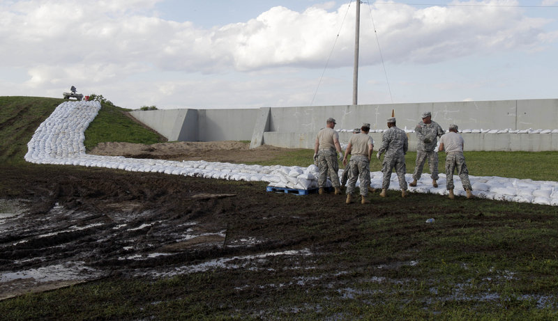 National Guardsmen from Missouri work to construct a temporary sandbag levee in Caruthersville, Mo., earlier this week. Officials hope the secondary levee catches any spillover if the Mississippi River tops the town's 50-foot flood wall. The forecast calls for a crest of 49.5 feet on Sunday afternoon in the town still recovering from a tornado six years ago.