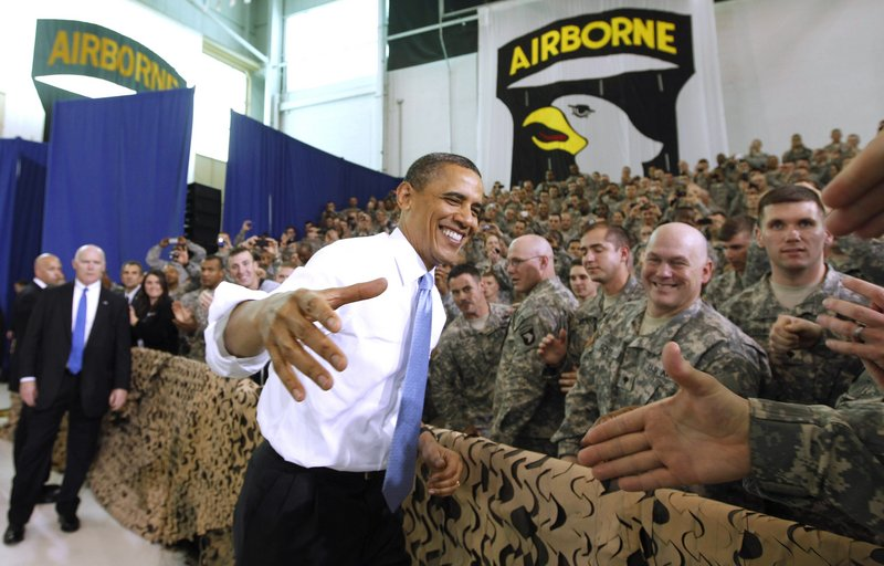 "President Obama greets military personnel prior to addressing troops Friday at Fort Campbell, Ky. Obama also met privately with the commandos he sent after terror mastermind Osama bin Laden. Obama called the bin Laden raid one of the most successful intelligence and military operations in America's history, and said he had to come to extend personal thanks. Obama said his meeting with special operations forces ""was a chance for me to say on behalf of all Americans and people around the globe, job well done, job well done."" The identities of the men who killed bin Laden are likely to remain secret forever. White House officials released few details of Friday's meetings and would not formally confirm whether Obama actually met members of Navy SEAL Team 6, whose existence is officially classified."