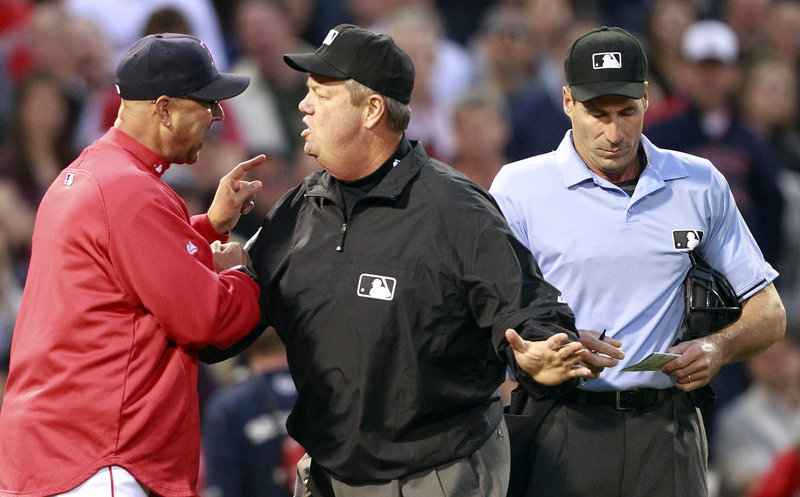 Umpire Joe West gets between Boston Manager Terry Francona, left, and home plate umpire Angel Hernandez after Hernandez ejected Francona for arguing a balk in the second inning of Minnesota's 9-2 win Friday in Boston.