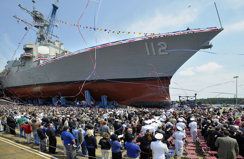 Streamers fly and the crowd applauds after the christening of the Michael Murphy (DDG 112) Saturday at Bath Iron Works. Fabrication of the warship began in September 2007, a month before Maureen Murphy accepted the Medal of Honor for her son.