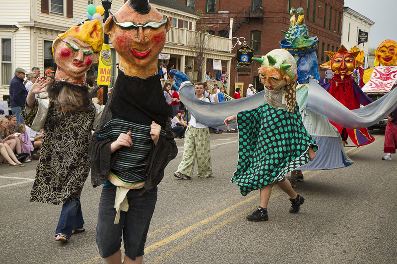 Human puppets from Shoestring dance their way down Main Street.