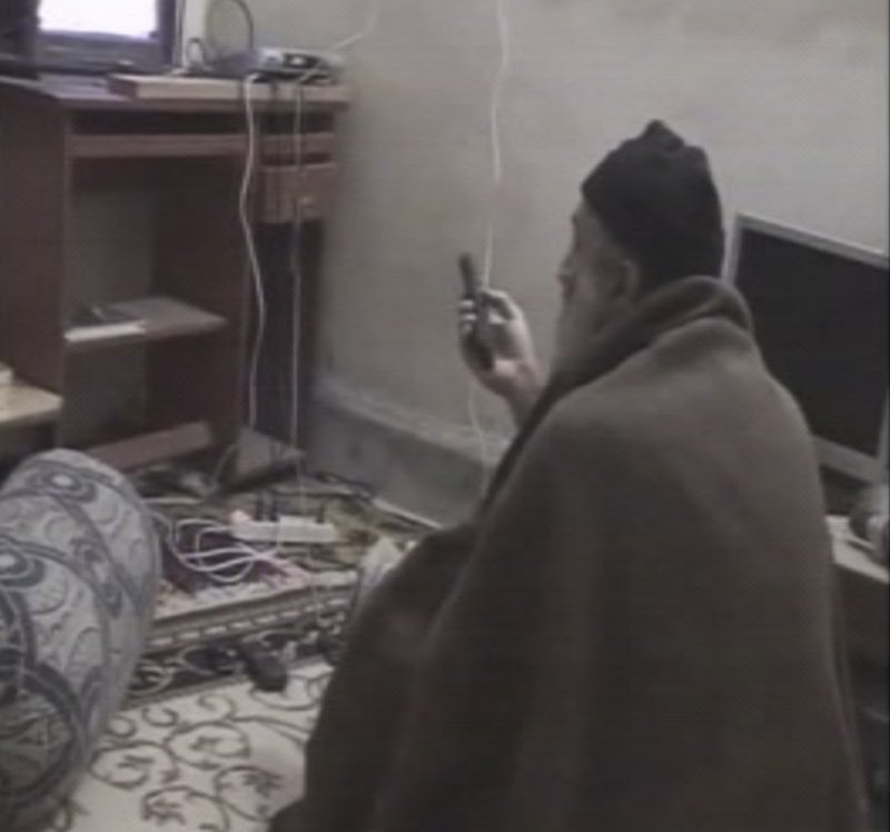 A man the U.S. government says is Osama bin Laden watches TV in this image from video released Saturday.