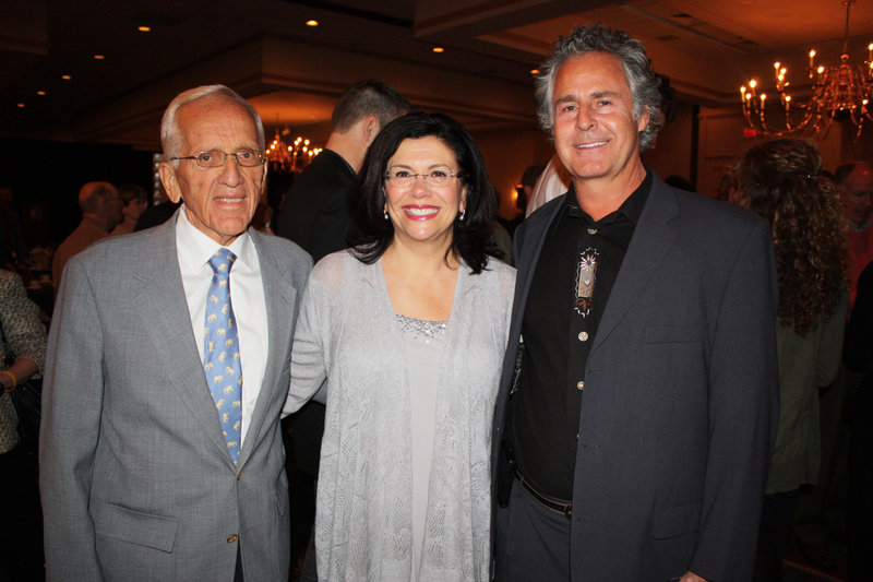 T. Colin Campbell, left, with Barbara Gulino, marketing leader at Whole Foods Market, where Campbell signed books earlier in the day, and Dr. John Herzog at the Mercy Hospital banquet where Campbell spoke last week.