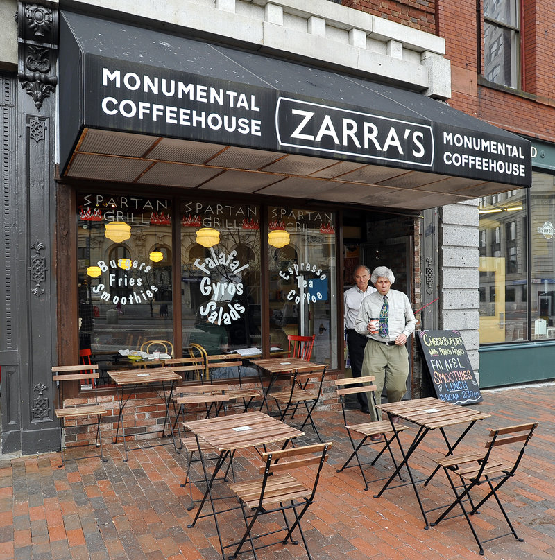 Customers head to the outside seating area on Monument Square.