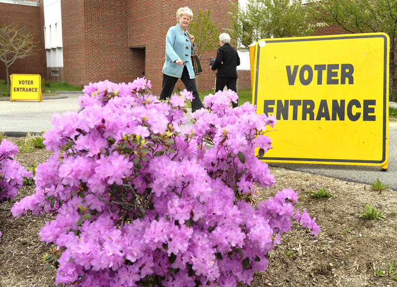 Cape Elizabeth residents use the polling station at the high school Tuesday.