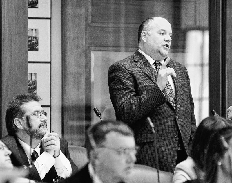 Rep. Lance Evans Harvell, R-Farmington, talks about health insurance reform legislation during debate Tuesday in the House. Some readers say there hasn't been enough discussion.