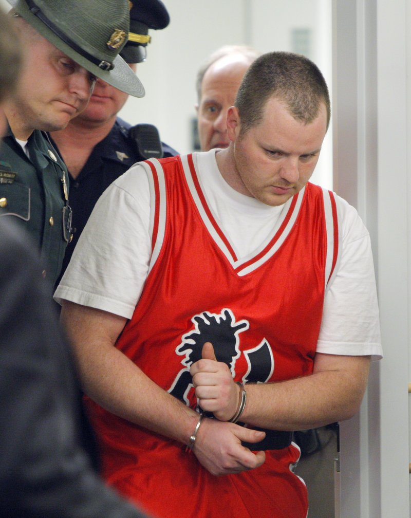 Anthony Papile is led Wednesday into Ossipee District Court in New Hampshire, where he was arraigned on a murder charge in the slaying of Krista Dittmeyer. Authorities said he ambushed Dittmeyer and struck her three times in the head with a rubber club.